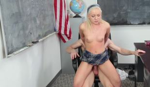 Golden-haired with a nice round butt is getting her pussy rammed in the classroom