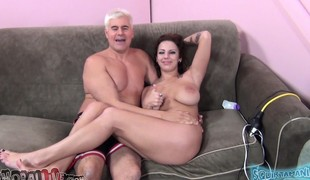Giant breasted brunette Lylith Lavey deepthroats and fucks a large stick