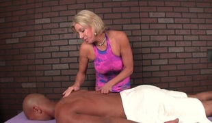 Smoking femdom masseuse tugging clients penis