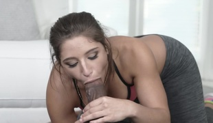 A bimbo is receiving a thick cock in her mouth and she's sucking it well