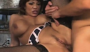Stacked Oriental cougar in black nylons engages in a wild threesome