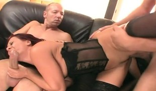 Ravishing redhead cougar in black underware gets fucked by two males