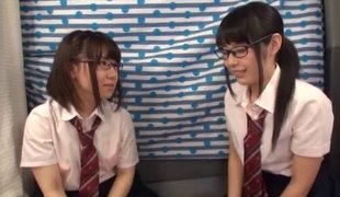 Japanese teens in glasses suck on his unbending dick together