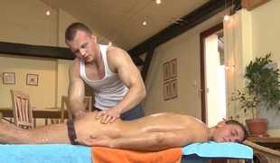 Cute twink gets a lusty massage from homo chap