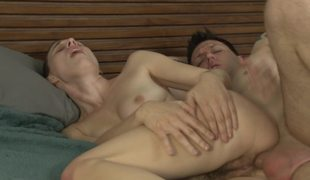 A chick with a nice couple of bumpers is getting fucked hard on the bed