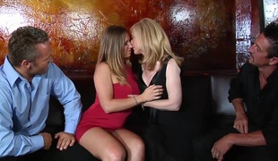 Captivating blond with large tits in stocking getting banged doggystyle in foursome