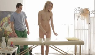 Tall blonde enticed by a horny masseur during a relaxing session