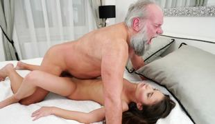 A bimbo that loves old men is screwed on the bed deeply