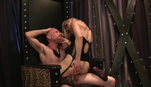 Ash Hollywood is a hot domina that has her latex outfit on. The golden-haired pornstars is on top of a guy and she is forcing him to lick her feet. Her moves are strict.