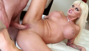 Nikita Von James bounces up and down on meat pole