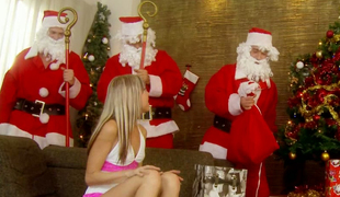 Petite blondie gives irrumation to a group of kinky Santas