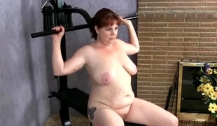 In nature's garb mature redhead with a corpulent ass working out