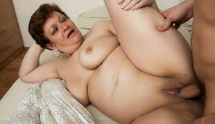 Chubby granny gets a penis in her arse