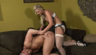 A blonde dominatrix permeates her slave with her thong on