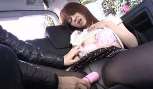 Oriental cowgirl gratified with nice toy in the car close up shoot
