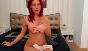 Hot stripteasing redhead playgirl seduces on livecam with her sexy body