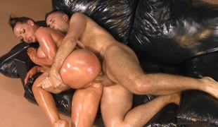 A kinky milf is getting her body oiled up and permeated