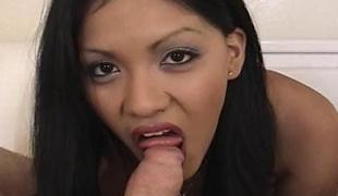 Soaked and raw Oriental slut gobbles up a fat pecker