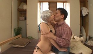 White haired Japanese chick in striped stockings loves to fuck