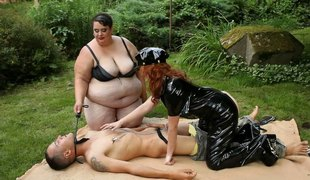 Leather-clothed chick and her fat friend in the hottest threesome