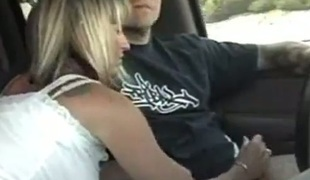 Lustful blonde MILF jerking off uncle's dick during the time that he's driving
