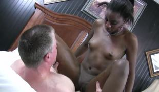 Dark chick that loves to ride cock is pulling a white one with her hands