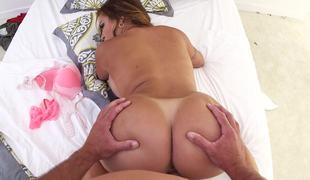 A milf with a large butt with tan lines is sucking a large pecker