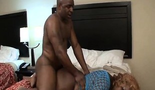 Curvy ebon lady with a giant booty takes on a dark pole on the bed