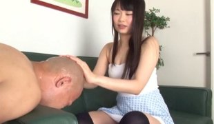 Long-haired cutie from Japan gives her buddy a nice handjob