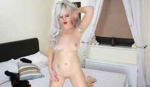 White haired British temptress disrobes sensually