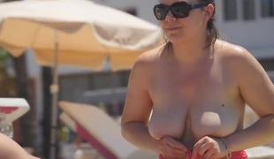 See lots of non-professional breasts on the beach