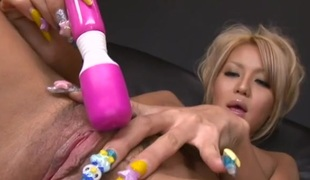 Oriental glamour golden-haired turned on by her toys