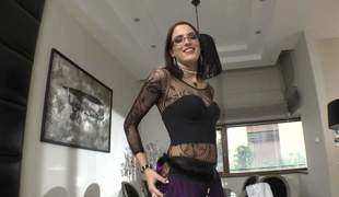 Flirty brunette Lyen Parker clothed in black discloses her natural tits and flaunts her consummate ass. Honey with glasses shows her assets right in front of the cam. She is super sexy
