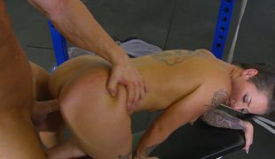 A seductive temptress is getting penetrated in the gym by a man