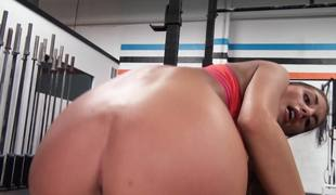 A sexy and sporty girl is getting her wazoo worshiped by her male friend