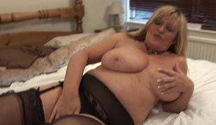Bulky MILF with big tits Alisha loves fingering her wet twat