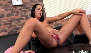 Exquisite nympho is pissing and finger fucking shaven cunt