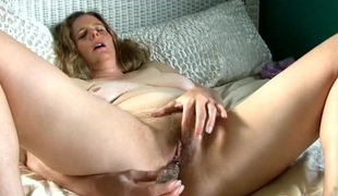 Purple lace panties taut on the hairy milf