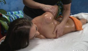 Luscious ass brunette oiled up and drilled on a massage table