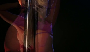 Britney is a lewd stripper who satisfies herself on the pole