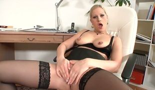 Blonde Sandra De Marco strips and masturbates